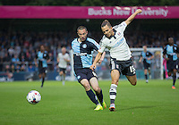 Kay Voser of Fulham knocks Michael Harriman of Wycombe Wanderers off the ball during the Capital One Cup match between Wycombe Wanderers and Fulham at Adams Park, High Wycombe, England on 11 August 2015. Photo by Andy Rowland.