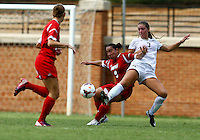 WINSTON-SALEM, NORTH CAROLINA - September 01, 2013:<br />  Charlyn Corral (9) of Louisville University battles for the ball against Sarah Teegarden (7) of Wake Forest University during a match at the Wake Forest Invitational tournament at Wake Forest University on September 01. The match was abandoned early in the second half due to severe weather with Wake leading 1-0.
