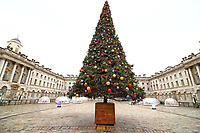 Somerset House reopens after the end of the second coronavirus lockdown and unveils it's 2020 christmas tree along with some pop up dining domes, forming a new festive foodie experience. London December 3rd 2020<br /> <br /> Photo by Keith Mayhew