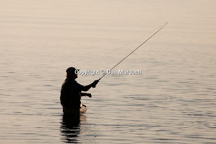 Senior flyfishing early morning