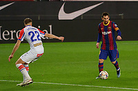 13th February 2021; Camp Nou, Barcelona, Catalonia, Spain; La Liga Football, Barcelona versus Deportivo Alaves; Leo Messi FC Barcelona comes forward on the ball covered by Florian Lejeune