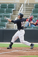 Brett Austin (10) of the Kannapolis Intimidators follows through on his swing against the Lakewood BlueClaws at CMC-NorthEast Stadium on July 20, 2014 in Kannapolis, North Carolina.  The Intimidators defeated the BlueClaws 7-6. (Brian Westerholt/Four Seam Images)