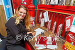 Melissa O'Riordan writing her latter to Santa at the North Pole post office in Sheahan's Centra Killarney on Monday