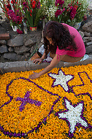 Mexico, Mixquic. Day of the Dead, Dia de los Muertos. Church of San Andres Apostol. People decorating graves. MR