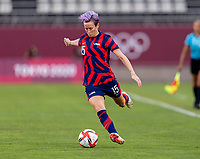 KASHIMA, JAPAN - AUGUST 5: Megan Rapinoe #15 of the USWNT passes the ball during a game between Australia and USWNT at Kashima Soccer Stadium on August 5, 2021 in Kashima, Japan.