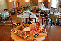 - inside of Little White Horse restaurant, typical sausages....- interno del ristorante Cavallino Bianco, salumi tipici