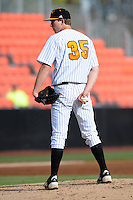 Pitcher Conner Stevens #35 delivers a pitch during a  game against the Kentucky Wildcats at Lindsey Nelson Stadium on March 24, 2012 in Knoxville, Tennessee. The game was suspended in the bottom of the 5th with the Wildcats leading 5-0. Tony Farlow/Four Seam Images.