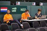 Switserland, Genève, September 16, 2015, Tennis,   Davis Cup, Switserland-Netherlands, Practise Dutch team, team doctor Babette Pluim, team manager Guus van Berkel and Fysio EdwinVisser( rtl)<br /> Photo: Tennisimages/Henk Koster