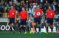 Match officials walk out for the Football United Tour match between Wellington Phoenix and Newcastle United at Westpac Stadium, Wellington, New Zealand on Saturday, 26 July 2014. Photo: Justin Arthur / lintottphoto.co.nz