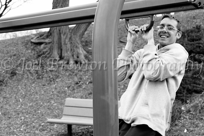 A young man proves that age knows no bounderies as he swings from the playground equipment at Frick Park, Pittsburgh.