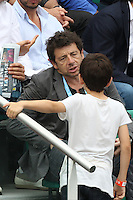 Patrick Bruel and his son seen watching tennis during Roland Garros tennis open 2016 on may 28 2016.