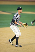 Wake Forest Demon Deacons third baseman Justin Yurchak (20) on defense against the \nh\ at Wake Forest Baseball Park on March 20, 2015 in Winston-Salem, North Carolina.  The Hurricanes defeated the Demon Deacons 15-2.  (Brian Westerholt/Four Seam Images)