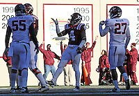 Nov 27, 2010; Charlottesville, VA, USA; Virginia Tech Hokies running back David Wilson (4) signals to the crowd after scoring a touchdown in front of Virginia Cavaliers linebacker Jared Detrick (55) and Virginia Cavaliers cornerback Rijo Walker (27) during the game at Lane Stadium. Virginia Tech won 37-7. Mandatory Credit: Andrew Shurtleff