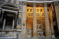 Statues, ornate columns and paintings inside the Pantheon, Rome, Italy.