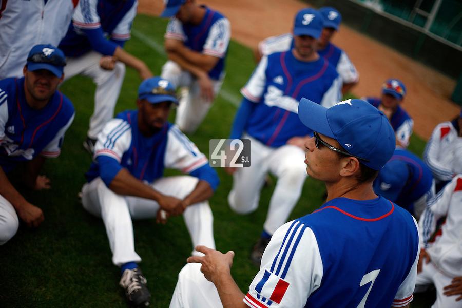 25 June 2011: Team manager Fabien Proust of Team France talks to his player following Czech Republic 11-1 win over France, at the 2011 Prague Baseball Week, in Prague, Czech Republic.
