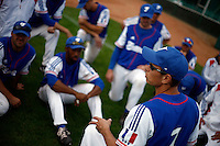 25 June 2011: Team manager Fabien Proust of Team France talks to his player following Czech Republic 11-1 win over France, at the 2011 Prague Baseball Week, in Prague, Czech Republic.
