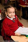 K-8 Parochial School Bronx New York Grade 1 portrait of girl holding language arts fill in the bubbles worksheet vertical