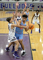 Fort Smith Southside's Yazed Taforo (center) is pressured in the lane Tuesday, Jan. 12, 2021, by Fayetteville's Jack Erck (left) and Matt Wayman (top) during the first half of play in Bulldog Arena. Visit nwaonline.com/210113Daily/ for today's photo gallery. <br /> (NWA Democrat-Gazette/Andy Shupe)