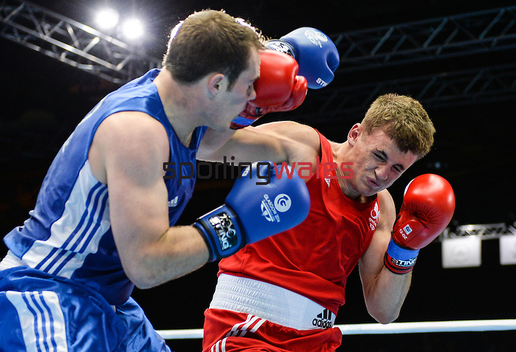 Wales Kody Davies in action against Scotlands Stephen Lavelle<br /> <br /> Photographer Ian Cook/Sportingwales<br /> <br /> 20th Commonwealth Games - Boxing -  Day 4 - Sunday 27th July 2014 - Glasgow - UK