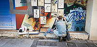 Pictured: A street artist prepares his work of arts.<br /> Re: Street photography, Athens, Greece. Thursday 27 February 2020