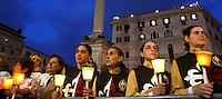 L'arrivo della processione del Corpus Domini dalla Basilica di San Giovanni in Laterano alla Basilica di Santa Maria Maggiore, a Roma, 30 maggio 2013.<br /> Believers hold candles during the Corpus Domini procession from St. John Lateran Basilica to St. Mary Major Basilica, in Rome, 30 May 2013. <br /> UPDATE IMAGES PRESS/Riccardo De Luca<br /> <br /> STRICTLY ONLY FOR EDITORIAL USE
