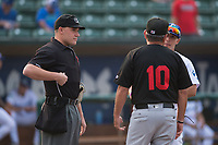 Home plate umpire Bobby Tassone meets with managers Jeremy Rodriguez (Ogden) and Tim Esmay (Great Falls) before a Pioneer League game between the Ogden Raptors and the Great Falls Voyagers at Lindquist Field on August 23, 2018 in Ogden, Utah. The Ogden Raptors defeated the Great Falls Voyagers by a score of 8-7. (Zachary Lucy/Four Seam Images)
