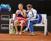 Februari 08, 2015, Apeldoorn, Omnisport, Fed Cup, Netherlands-Slovakia,   Magdaléna Rybáriková (SLO) on the beng<br /> Photo: Tennisimages/Henk Koster