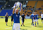 St Johnstone v Fleetwood Town…24.07.21  McDiarmid Park<br />Shaun Rooney holding the Scottish Cup leads the team mates on a lap of honour at McDiarmid Park showing the fans the two trophies<br />Picture by Graeme Hart.<br />Copyright Perthshire Picture Agency<br />Tel: 01738 623350  Mobile: 07990 594431