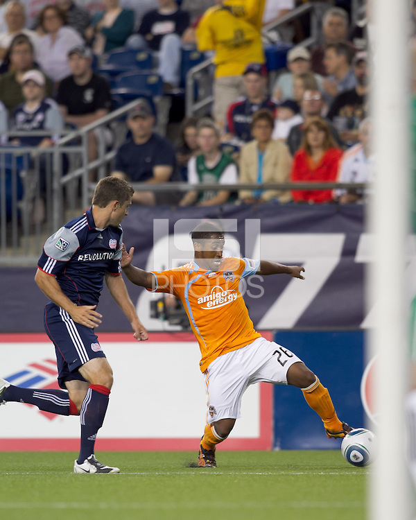 Houston Dynamo midfielder Corey Ashe (26) dribbles as New England Revolution midfielder Chris Tierney (8) pressures. The New England Revolution defeated Houston Dynamo, 1-0, at Gillette Stadium on August 14, 2010.