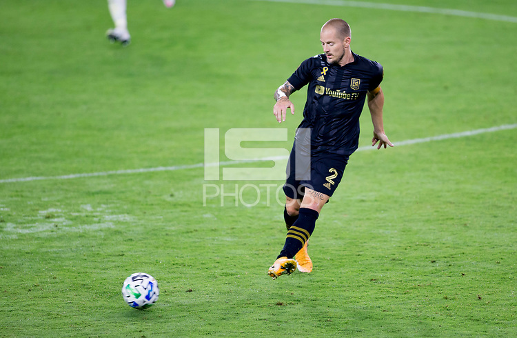 LOS ANGELES, CA - SEPTEMBER 23: Jordan Harvey #2 of LAFC moves to the ball during a game between Vancouver Whitecaps and Los Angeles FC at Banc of California Stadium on September 23, 2020 in Los Angeles, California.