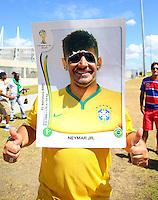 A fan wearing a Neymar Panini sticker as fancy dress outside the Estadio Castelao