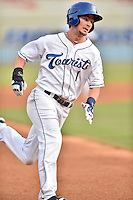 Asheville Tourists shortstop Brendan Rodgers (1) runs to third during a game against the  Greenville Drive at McCormick Field on June 3, 2016 in Asheville, North Carolina. The Tourists defeated the Drive 6-5. (Tony Farlow/Four Seam Images)