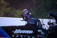 May 15, 2015; Commerce, GA, USA; NHRA top fuel driver Cory McClenathan gets out of his car during qualifying for the Southern Nationals at Atlanta Dragway. Mandatory Credit: Mark J. Rebilas-USA TODAY Sports
