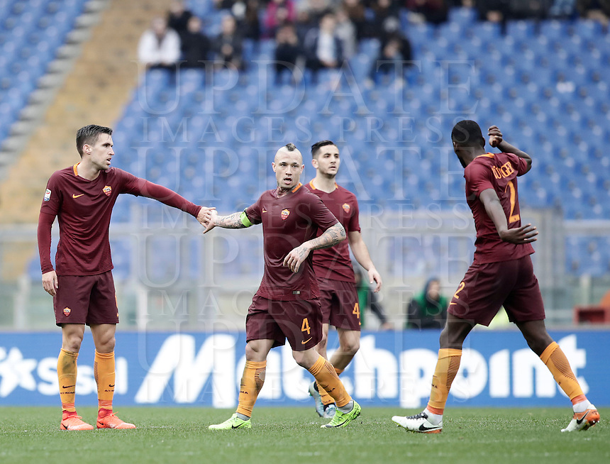 Roma's Kevin Strootman, left, is congratulated by teammates during the Italian Serie A football match between Roma and Napoli at Rome's Olympic stadium, 4 March 2017. <br /> UPDATE IMAGES PRESS/Isabella Bonotto