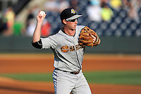 Third baseman Ryan Lindemuth (10) of the Charleston RiverDogs warms up before a game against the Greenville Drive on Monday, June 29, 2015, at Fluor Field at the West End in Greenville, South Carolina. Greenville won, 4-2. (Tom Priddy/Four Seam Images)