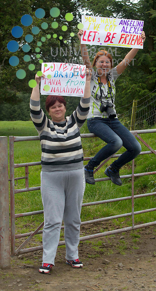 Carnell Estate - Hurlford, Scotland.  Fans Tatina Kalinshank (54) and daughter Irina Gygina (32) both originally from Moscow but now live in Uddingston, hold up poster's outside for Angelina Jolie and Brad Pitt at the Carnell Estate in Hurlford - film World War Z ..Picture: Universal News And Sport (Scotland). 21 August 2011. www.unpixs.com..
