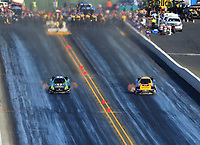 Jul 29, 2017; Sonoma, CA, USA; NHRA funny car driver Alexis DeJoria (left) races alongside teammate J.R. Todd during qualifying for the Sonoma Nationals at Sonoma Raceway. Mandatory Credit: Mark J. Rebilas-USA TODAY Sports