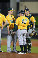 Siena Saints pitcher Matt Quintana (30) and catcher Dan Vasquez (19) talk with head coach Tony Rossi (40) during the season opening game against the Central Florida Knights at Jay Bergman Field on February 14, 2014 in Orlando, Florida.  UCF defeated Siena 8-1.  (Mike Janes/Four Seam Images)