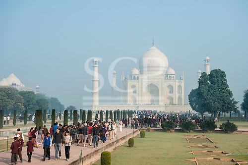 Agra, Utar Pradesh, India.Taj Mahal in the morning mist and tourists.
