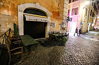 A view of a desert street with a closed  cafe in Rome, Italy, March 10, 2020. The Italian government imposed restriction aimed to contain the Covid-19 spread, including cafes, restaurants and other shops forced to close at 6pm and forbidding personal movement.<br /> UPDATE IMAGES PRESS/Riccardo De Luca