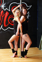 Pictured L-R: Sian O'Shea andTina Lediard. Saturday 22 February 2014<br /> Re: Eight women have attempted to set a new world record of most people pole dancing at the same time.<br /> Pole 4 Life world record attempt was organised by Lisa Broughton at her Pole Twisters dance studio in Cardiff.<br /> The women had to pole dance for six minutes to set the new record.