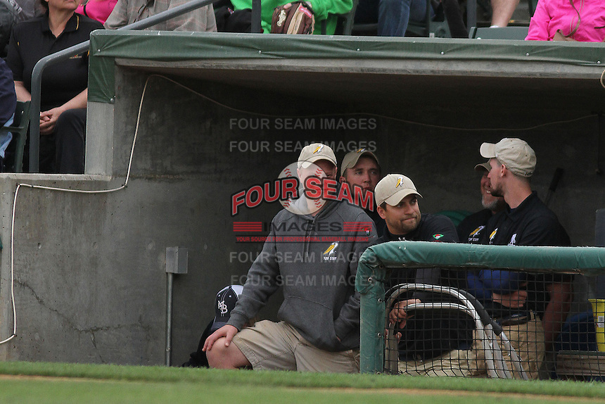Myrtle Beach Pelicans grounds crew in the dugout during a game against the Salem Red Sox at Ticketreturn.com Field at Pelicans Ballpark on April 6, 2014 in Myrtle Beach, South Carolina. Salem defeated Myrtle Beach 3-0. (Robert Gurganus/Four Seam Images)