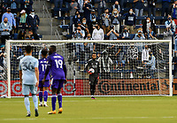 KANSAS CITY, KS - APRIL 23: Pedro Gallese #1 of Orlando City SC looks for an open man after stopping a shot on goal during a game between Orlando City SC and Sporting Kansas City at Children's Mercy Park on April 23, 2021 in Kansas City, Kansas.