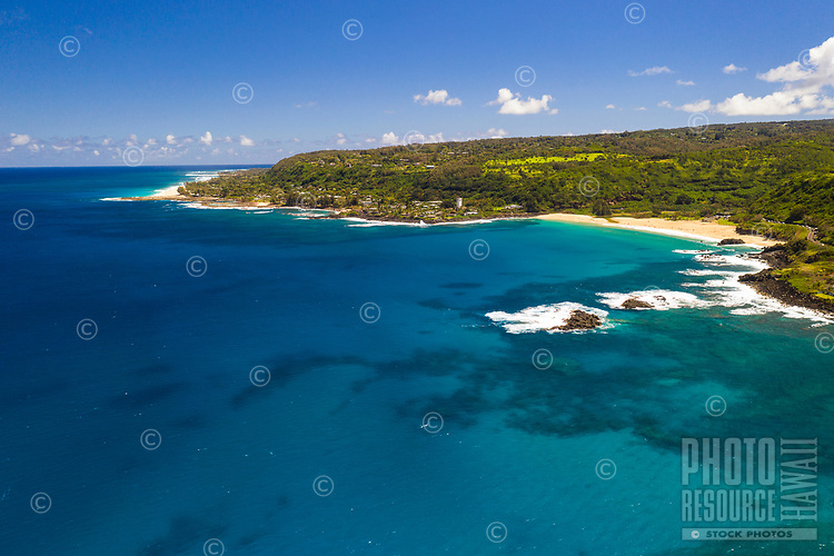 An aerial view of Waimea Bay and Beach on the North Shore of O'ahu.