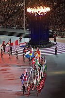 12 AUG 2012 - LONDON, GBR - Flagbearers parade beside the Olympic Flame during the London 2012 Olympic Games Closing Ceremony in the Olympic Stadium in the Olympic Park, Stratford, London, Great Britain (PHOTO (C) 2012 NIGEL FARROW)