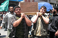 """Palestinian carry bodies  thrwe go to funeral of Hamas militants in Gaza Cityl  nine Palestinians killed by an Israeli air strike in Gaza May 21, 2007. Israel launched more strikes against Gaza militants on Sunday, killing nine Palestinians in two aerial assaults, including one that struck the home of a prominent Hamas politician, security officials said.  photo by Fady Adwan"""""""