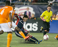New England Revolution midfielder Kelyn Rowe (11) slides to intercept the ball in front of Houston Dynamo midfielder Warren Creavalle (5).  The New England Revolution played to a 1-1 draw against the Houston Dynamo during a Major League Soccer (MLS) match at Gillette Stadium in Foxborough, MA on September 28, 2013.