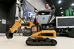 A man operates a construction machinery robot during SoftBank Robot World 2017 on November 21, 2017, Tokyo, Japan. SoftBank Robotics organized SoftBank Robot World 2017 to introduce AI (Artificial Intelligence) and IoT (the Internet of Things) companies developing the latest technology for robots, including applications its humanoid robot Pepper in various business fields. The robot expo runs until November 22. (Photo by Rodrigo Reyes Marin/AFLO)