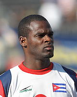 Cuban midfielder Jose Ciprian (9). In CONCACAF Gold Cup Group Stage, the national team of Cuba (white) defeated national team of Belize (red), 4-0, at Rentschler Field, East Hartford, CT on July 16, 2013.