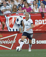 USWNT midfielder Lauren Cheney (12) looks to pass. In an international friendly, the U.S. Women's National Team (USWNT) (white/blue) defeated Korea Republic (South Korea) (red/blue), 4-1, at Gillette Stadium on June 15, 2013.